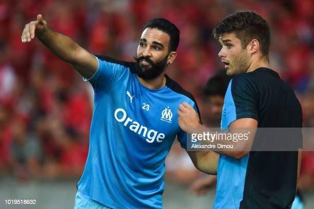 Adil Rami and Duje Caleta Car of Marseille during the French Ligue 1 match between Nimes and Marseille at Stade des Costieres on August 19 2018 in...
