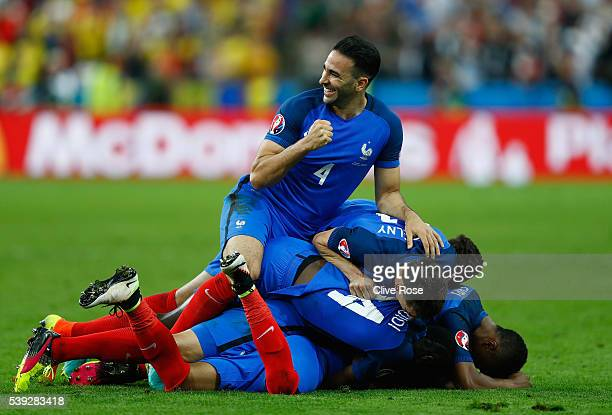 Adil Rami and French players celebrate their team's second goal scored by Dimitri Payet during the UEFA Euro 2016 Group A match between France and...