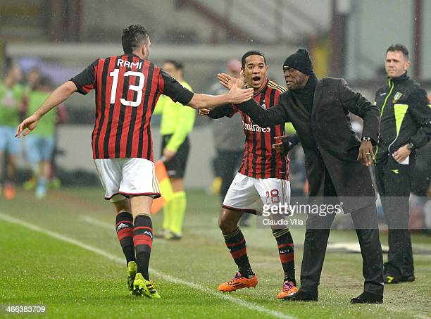 Adil Rami and head coach AC Milan Clarence Seedorf celebrate during the Serie A match between AC Milan and Torino FC at San Siro Stadium on February...