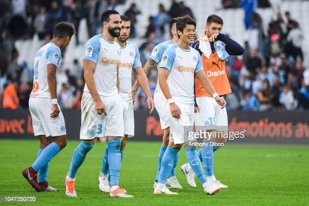Adil Rami and Hirko Sakai of Marseille celebrate the victory during the Ligue 1 match between Marseille and Caen at Stade Velodrome on October 7 2018...