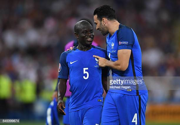Adil Rami and N'Golo Kante of France celebrate after their team's 20 win in the UEFA EURO semi final match between Germany and France at Stade...