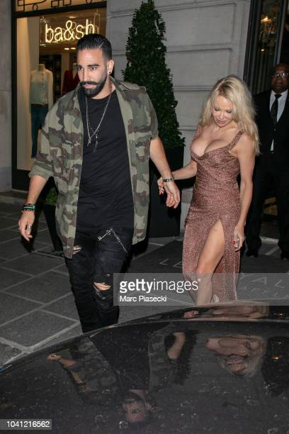 Adil Rami and Pamela Anderson are seen leaving the Royal Monceau hotel on September 26 2018 in Paris France