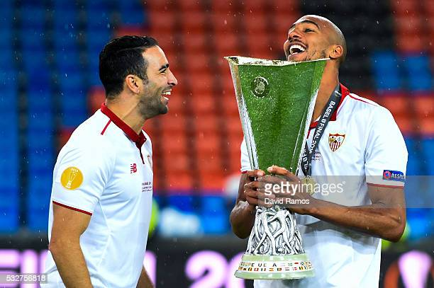 Adil Rami and Steven N'Zonzi of Sevilla FC celebrate with the trophy after the UEFA Europa League Final match between Liverpool and Sevilla at St...