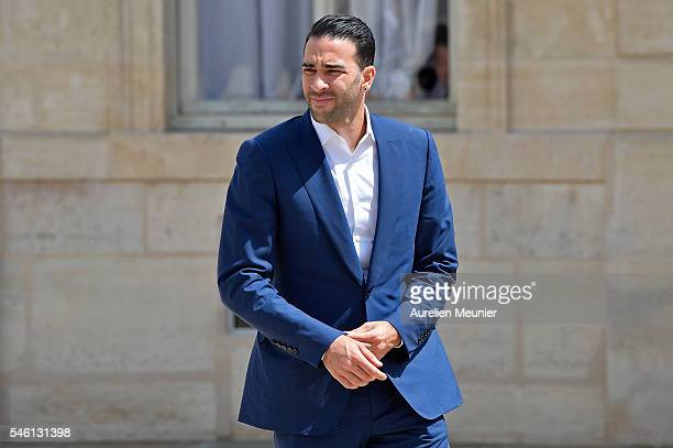 Adil Rami arrives at Elysee Palace as French President Francois Hollande receives the France Soccer team for a lunch on July 11 2016 in Paris France...