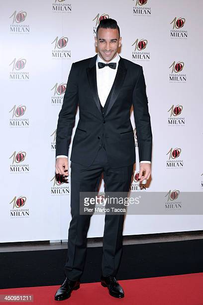 Adil Rami attends the Fondazione Milan 10th Anniversary Gala photocall on November 20 2013 in Milan Italy