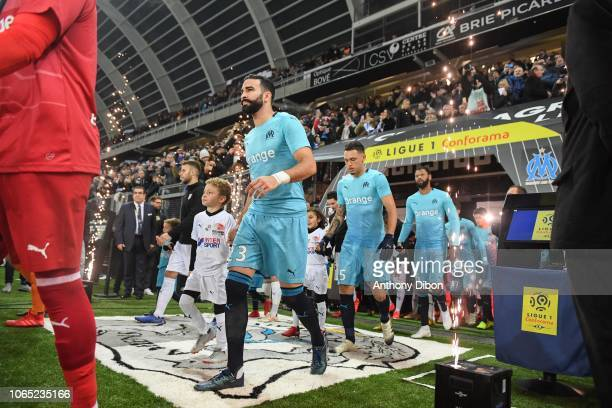 Adil Rami Lucas Ocampos and Rolando of Marseille during the Ligue 1 match between Amiens and Marseille at Stade de la Licorne on November 25 2018 in...