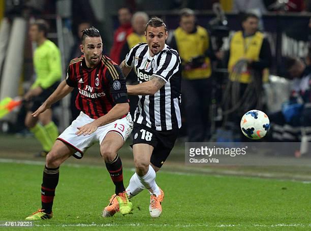 Adil Rami of AC Milan and Pablo Osvaldo of Juventus compete for the ball during the Serie A match between AC Milan and Juventus at San Siro Stadium...