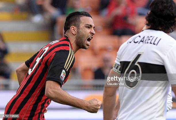 Adil Rami of AC Milan celebrates scoring the first goal during the Serie A match between AC Milan and Parma FC at San Siro Stadium on March 16 2014...