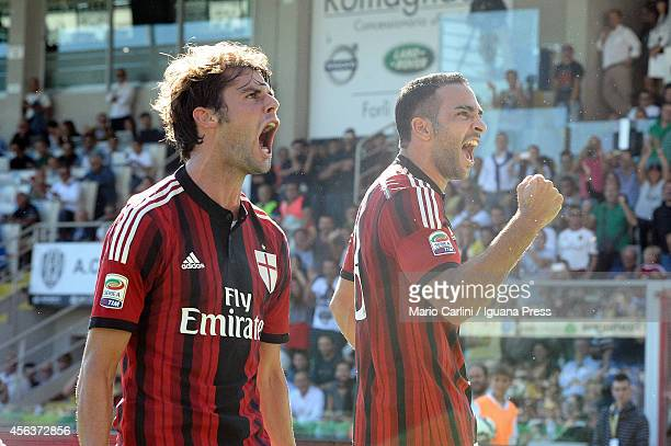 Adil Rami of AC Milan celebrates with his teamate Andrea Poli of AC Milan after scoring his team's first goal during the Serie A match between AC...