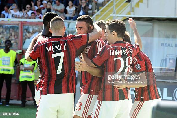 Adil Rami of AC Milan celebrates with his teamates after scoring his team's first goal during the Serie A match between AC Cesena and AC Milan at...