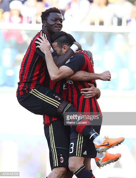 Adil Rami of AC Milan celebrates with his teammate Sulley Ali Muntari after scoring his team's second goal during the Serie A match between UC...