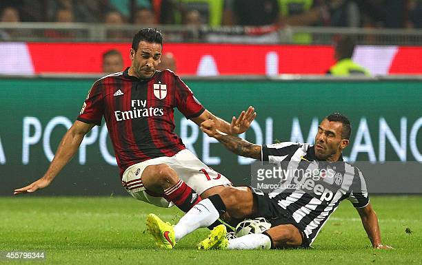 Adil Rami of AC Milan clashes with Carlos Tevez of Juventus FC during the Serie A match between AC Milan and Juventus FC at Stadio Giuseppe Meazza on...