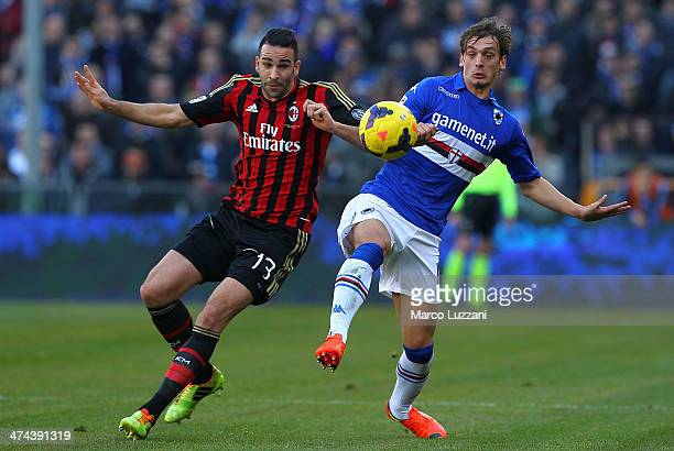 Adil Rami of AC Milan competes for the ball with Manolo Gabbiadini of UC Sampdoria during the Serie A match between UC Sampdoria and AC Milan at...