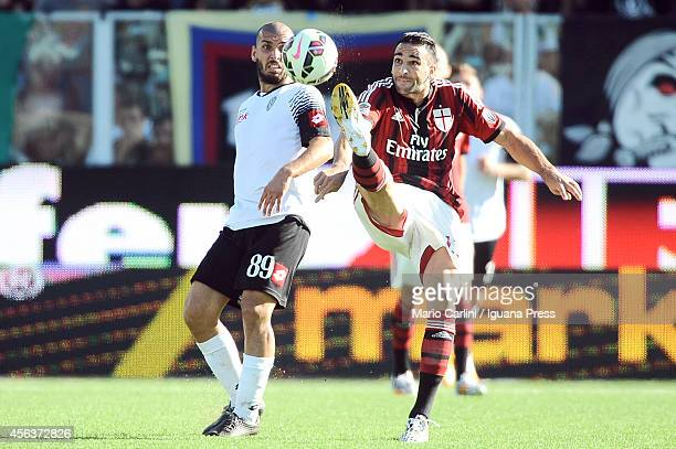 Adil Rami of AC Milan competes the ball with Guido Marilungo of AC Cesena during the Serie A match between AC Cesena and AC Milan at Dino Manuzzi...