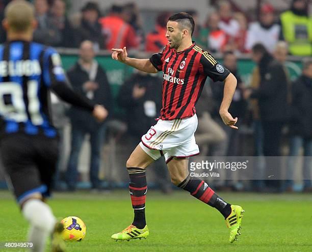 Adil Rami of AC Milan in action during the Serie A match between AC Milan and Atalanta BC at San Siro Stadium on January 6 2014 in Milan Italy