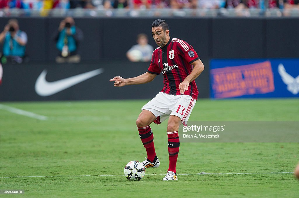 Adil Rami #13 of A.C. Milan passes the ball during first half action against Liverpool in the Guinness International Champions Cup at Bank of America Stadium on August 2, 2014 in Charlotte, North Carolina. Liverpool defeated A.C. Milan 2-0.