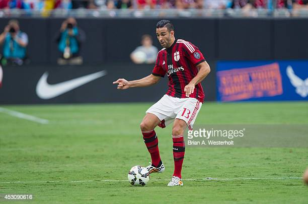 Adil Rami of AC Milan passes the ball during first half action against Liverpool in the Guinness International Champions Cup at Bank of America...