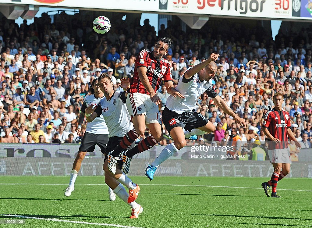 Adil Rami # 13 of AC Milan scores his team's first goal during the Serie A match between AC Cesena and AC Milan at Dino Manuzzi Stadium on September 28, 2014 in Cesena, Italy.