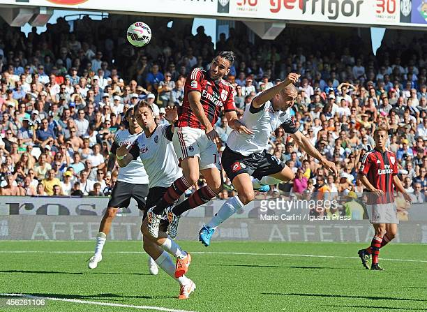 Adil Rami of AC Milan scores his team's first goal during the Serie A match between AC Cesena and AC Milan at Dino Manuzzi Stadium on September 28...
