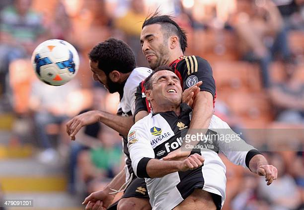 Adil Rami of AC Milan scores the first goal during the Serie A match between AC Milan and Parma FC at San Siro Stadium on March 16 2014 in Milan Italy