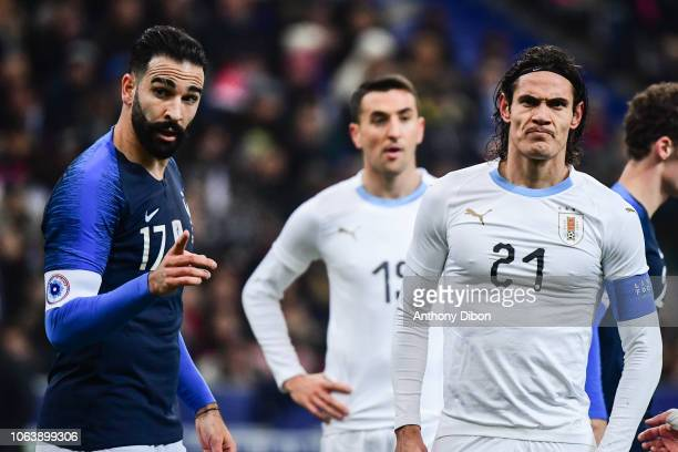 Adil Rami of France and Edinson Cavani of Uruguay during the International Friendly match between France and Uruguay at Stade de France on November...