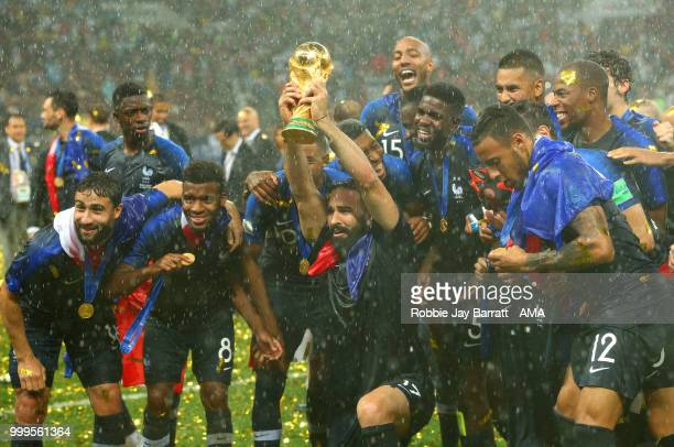 Adil Rami of France and his teammates celebrate victory with the FIFA World Cup trophy at the end of of the 2018 FIFA World Cup Russia Final between...