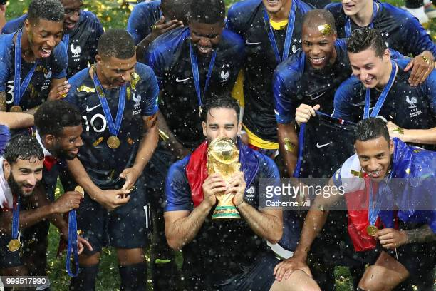 Adil Rami of France and his teammates celebrate with the World Cup Trophy following their sides victory in the 2018 FIFA World Cup Final between...