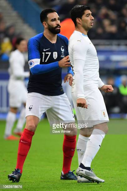 Adil Rami of France and Luis Suarez of Uruguay during the International Friendly match between France and Uruguay at Stade de France on November 20...