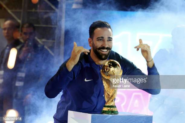 Adil Rami of france celebrate the FIFA World Cup with fan after the UEFA Nations League A group one match between France and Netherlands at Stade de...