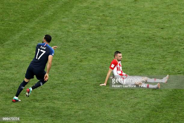 Adil Rami of France celebrates following his sides victory as Marcelo Brozovic of Croatia looks dejected following his sides defeat in the 2018 FIFA...