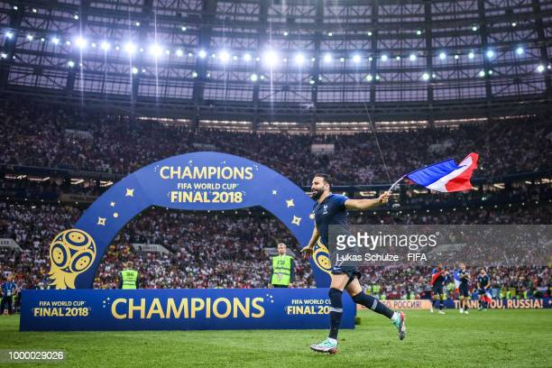 Adil Rami of France celebrates with a flag after winning the 2018 FIFA World Cup Russia Final between France and Croatia at Luzhniki Stadium on July...