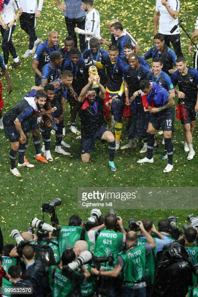 Adil Rami of France celebrates with the World Cup Trophy following his sides victory in the 2018 FIFA World Cup Final between France and Croatia at...