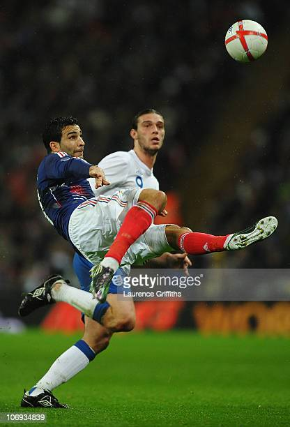 Adil Rami of France clears the ball ahead of Andy Carroll of England during the international friendly match between England and France at Wembley...