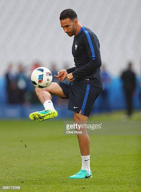 Adil Rami of France in action during training session ahead of the UEFA EURO 2016 Group A match between France and Romania at Stade de France on June...