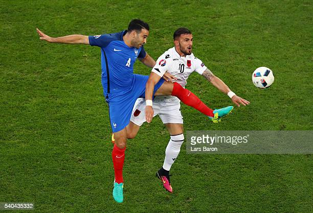 Adil Rami of France makes a challenge on Armando Sadiku of Albania during the UEFA EURO 2016 Group A match between France and Albania at Stade...