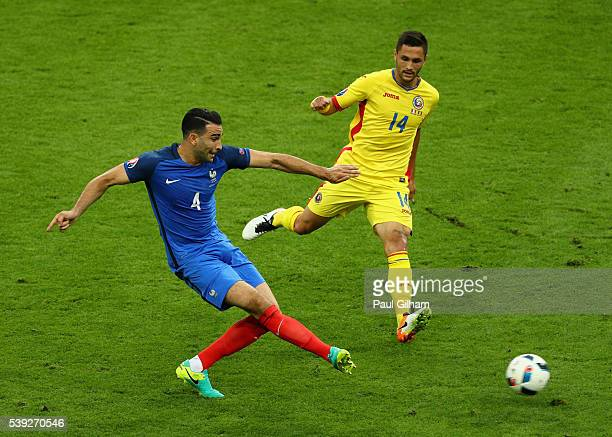 Adil Rami of France passes the ball during the UEFA Euro 2016 Group A match between France and Romania at Stade de France on June 10 2016 in Paris...