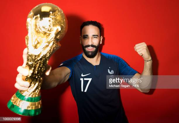 Adil Rami of France poses with the Champions World Cup trophy after the 2018 FIFA World Cup Russia Final between France and Croatia at Luzhniki...