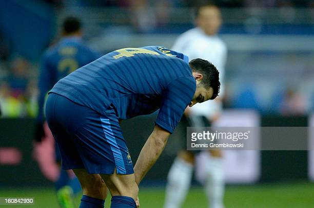 Adil Rami of France reacts during the international friendly match between France and Germany at Stade de France on February 6 2013 in Paris France