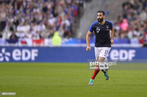 Adil Rami of France runs with the ball during the international friendly match between France and Republic of Ireland at Stade de France on May 28...