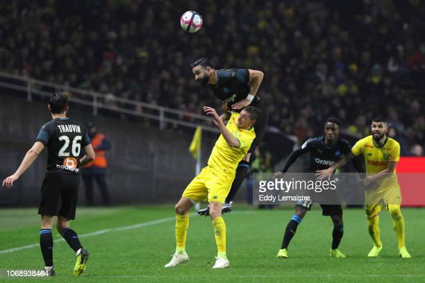 Adil Rami of Marseille and Emiliano Sala of Nantes during the French Ligue 1 match between FC Nantes and Olympique de Marseille on December 5 2018 in...