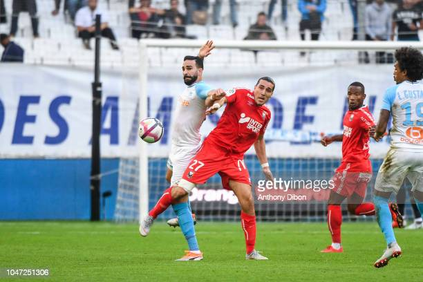 Adil Rami of Marseille and Enzo Crivelli of Caen during the Ligue 1 match between Marseille and Caen at Stade Velodrome on October 7 2018 in...