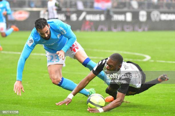 Adil Rami of Marseille and Karl Toko Ekambi of Angers during the Ligue 1 match between Angers SCO and Olympique Marseille at Stade Raymond Kopa on...