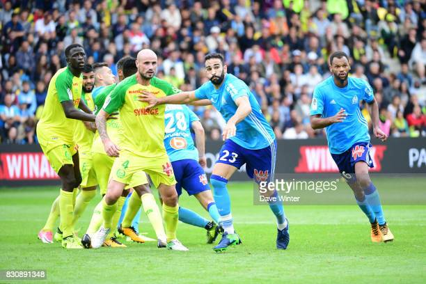 Adil Rami of Marseille and Nicolas Pallois of Nantes jostle for position at a corner during the Ligue 1 match between FC Nantes and Olympique...