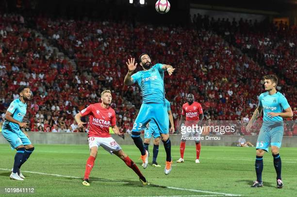 Adil Rami of Marseille and Renaud Ripart of Nimes during the French Ligue 1 match between Nimes and Marseille at Stade des Costieres on August 19...