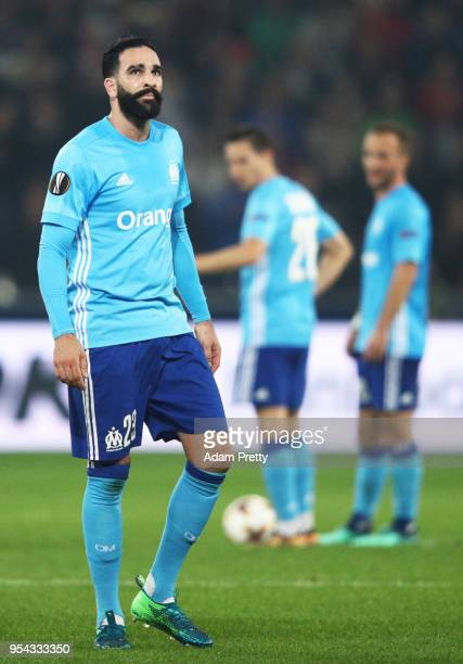 Adil Rami of Marseille looks dejected during the UEFA Europa Semi Final Second leg match between FC Red Bull Salzburg and Olympique de Marseille at...