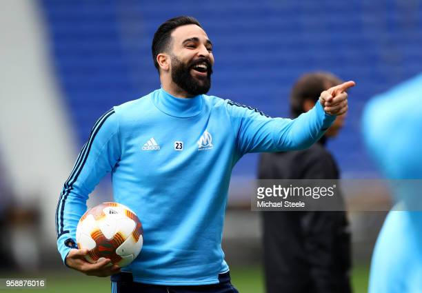 Adil Rami of Marseille looks on during an Olympique de Marseille training session ahead of the the UEFA Europa League Final against Club Atletico de...