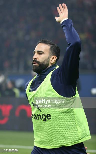Adil Rami of Marseille warms up during the French Ligue 1 match between Paris SaintGermain and Olympique de Marseille at Parc des Princes stadium on...