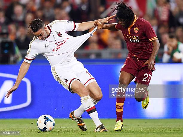 Adil Rami of Milan and Gervinho of Roma in action during the Serie A match between AS Roma and AC Milan at Stadio Olimpico on April 25 2014 in Rome...