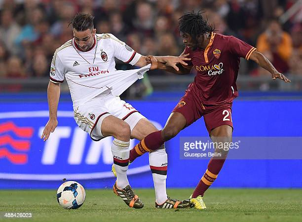 Adil Rami of Milan and Gervinho of Roma in action the Serie A match between AS Roma and AC Milan at Stadio Olimpico on April 25 2014 in Rome Italy