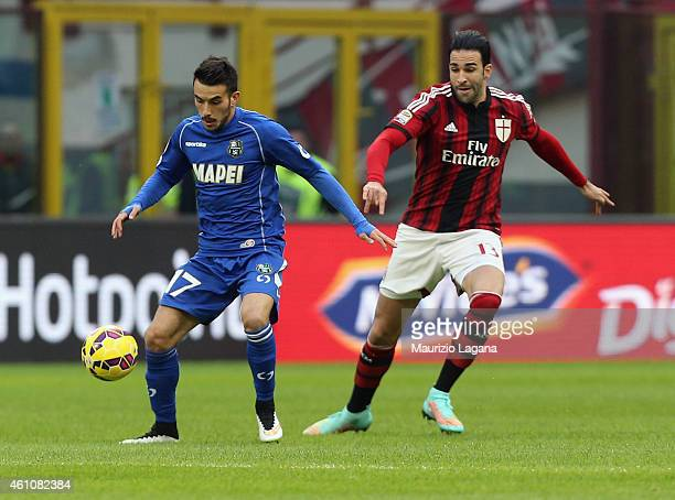 Adil Rami of Milan competes for the ball with Nicola Sansone of Sassuolo during the Serie A match between AC Milan and US Sassuolo Calcio at Stadio...